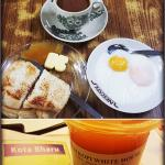 Toasts served with butter, sweet kaya and 2 half boiled eggs. With hot coffee..