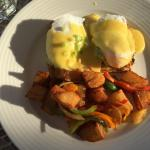 Asu- breakfast of avocado with poached eggs and hollandaise sauce and home fries.