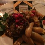 "Brown Bear & Reindeer ""meatloaf"" with fingerling potatoes and lingonberries."