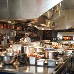 Open kitchen prepping for brunch - so fun to watch the chefs cool