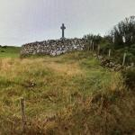 The cairn is right off the little road.