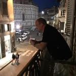 Overlooking the historic Florence nightlife with the Duomo in the background.
