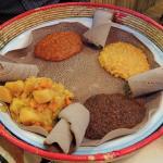 Vegetarian dish served atop a huge patty of Injera!