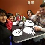 My family and I wating for our delicious Athenan pizza and chicken wings BBQ... IN MY BIRTHDAY!