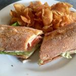 Poached chicken club sandwich and salad