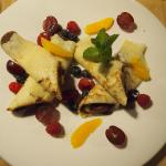 Delicious pan cakes with chocolate and fruits