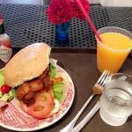 Grilled chicken focaccia sandwich and orange juice