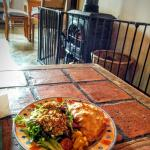 Homemade beef pastie with salad by the fire.