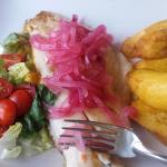 Red snapper with carmelized onions, salad and plantains