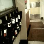 Decorative wine rack and small service station that guests pass through on the way to the restro
