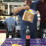 Mario proudly shows us Doz bag day old $12 Pork Tamales; a steal. $9.99 Tamale plate