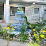 The statue of God Shiva of the hotel near garden.