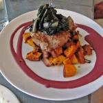 walnut crusted pork loin with chard, sweet potato, blackberry coulis