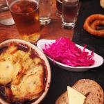 Lamb hot pot, red cabbage and fresh bread.