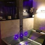 Glass bath tub with LED mood lighting