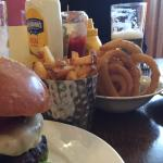Buffalo burger and beef burger with onion rings and French fries
