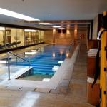 Lap pool in the basement next to the fitness area