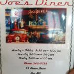 Diner menu cover with hours and phone number
