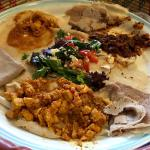 Delicious injera with accompanying meat and vegetables