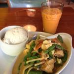 Green curry with tofu (spicy level 7) and iced Thai tea (less sweet) yum yum