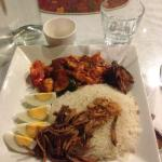 Nasi Lemark (coconut-flavored rice with curry chicken, dried fish, and boiled eggs)