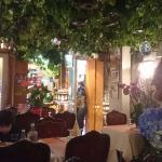 The hanging plants and tables before the restaurant got busy