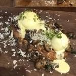 Poached eggs, on sourdough bread with mushrooms and hollandaise sauce