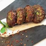 Zucchini balls with herbs and yogurt sauce