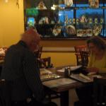 my friend and my husband, looking at lots of choices on the menu; beautiful pottery on display.