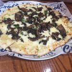 specialty thin crust mushroom pizza