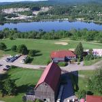 Aerial shot of the club with the Gatineau River and Hill in the background