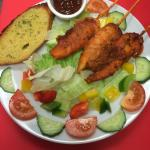 Chicken tikka skewers with salad and garlic bread. Scrum my