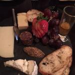 Cheese board has a wonderful selection of flavor combinations, beautifully presented.