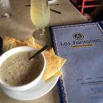 top shelf margaritas and queso; American cheese, blended with roasted hatch chile peppers and pi