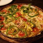 Pizza metade marguerita e metade portuguesa