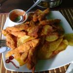 Chicken strips with potato chips and souce