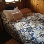 Full bed in main area of cabin.