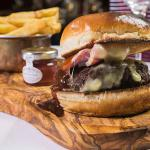 Great American Beef Burger with BBQ sauce, bacon Monterey Jack cheese, served with seasoned frie