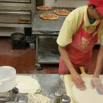 Watching the guy make pizza