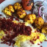 Zereshk Polo (Marinated charbroiled chicken tenderloin with rice barberry)