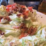 Wedge salad.  Half gone.   If you order like you would normally.   You are taking good home!!!