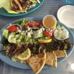 Fried Pita and Hummus,Lamb Soulavaki with Greek Salad on a bed of Rice, California Gyro In a hom