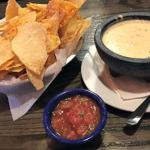 Extremely yummy cheese dip and salsa with chips