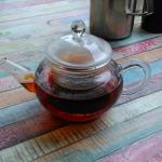 Your personal mini teapot with tea, Earl Grey, hot.