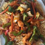 Crispy rice noodles with meat, chicken and vegetables