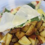 Spinach, tomato, mozzarella omelet with home fries