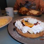 Fruit waffle at the front, Corned beef hash and eggs at the back of the picture.