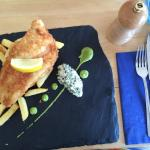 Gin battered fish and lemon salted chips, minted pea puree, caper and gherkin mayonnaise