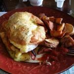 Croissant Benedict with deep fried breakfast potatoes... yum!