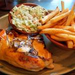 Quarter chicken (breast) with coleslaw and fries.